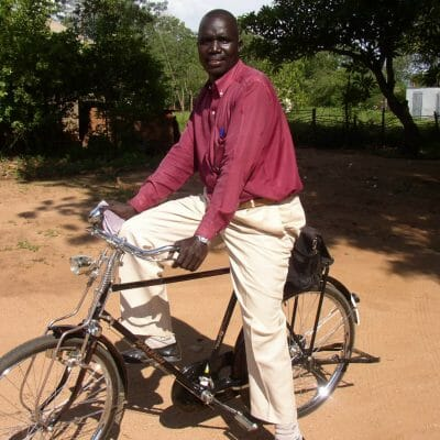 J39 Sudanese pastor on bicycle