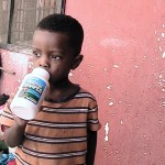 The little boy kissing his empty bottle of Animal shaped  vitamins
