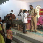 INBF Dalit School The chief guest a Police officer inaugurating the supply of school materials 20141