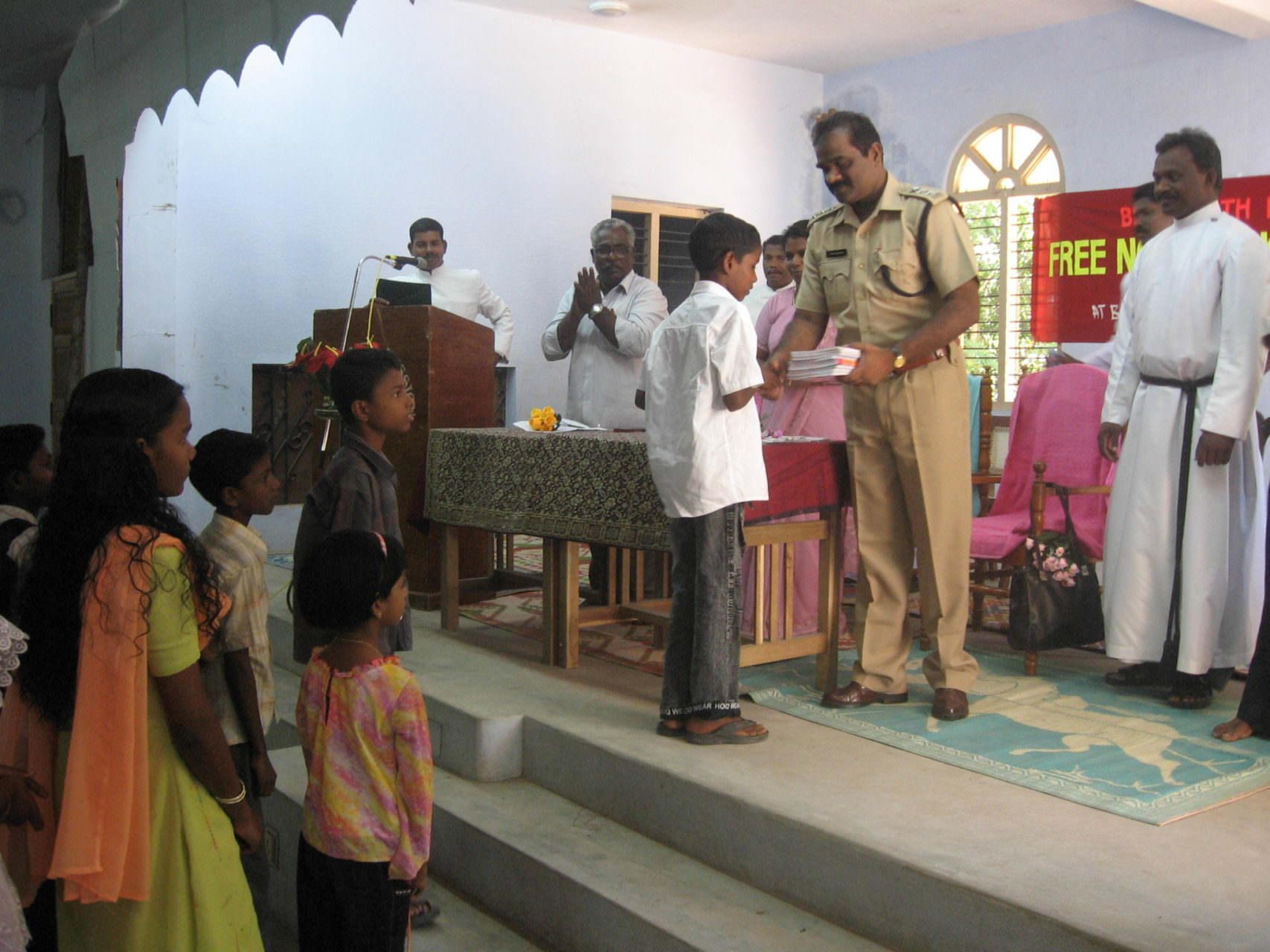 INBF-Dalit School-The chief guest a Police officer inaugurating the supply of school materials 2014