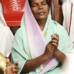 INBF Dalit woman praying 20111