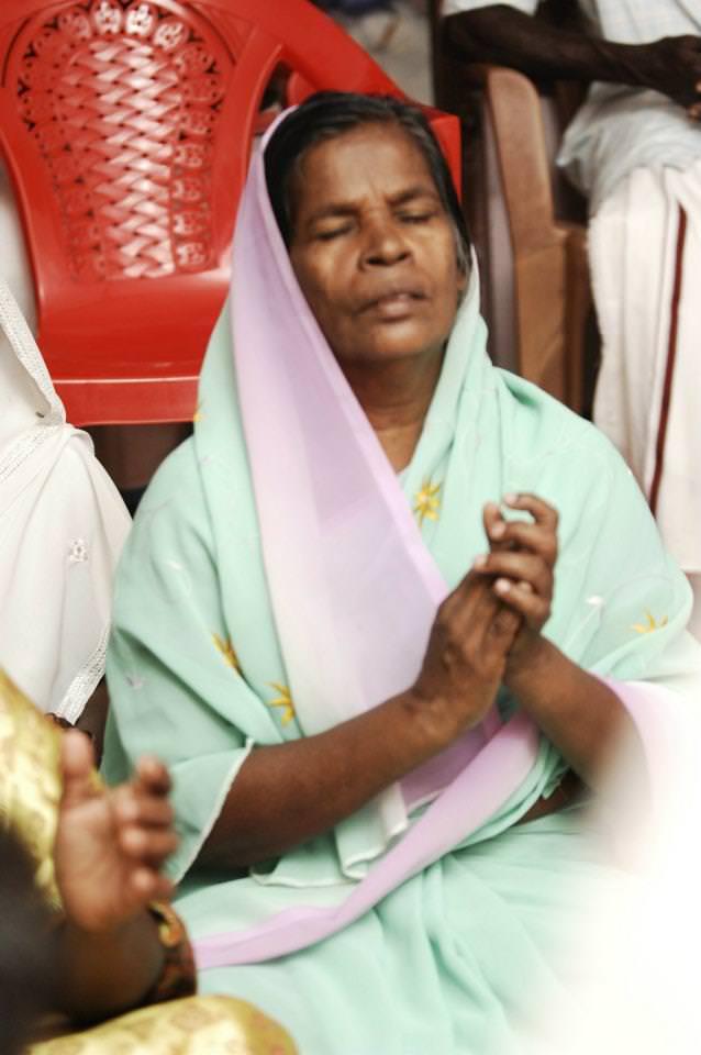 INBF-Dalit woman praying 2011