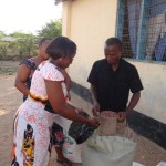 a lady receives her ration of beans