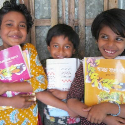 BACF Children are happy after getting new books July 20141
