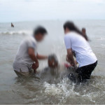 IOCS church planters baptizing new believer 2012 blurred