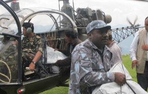GOD HELPED US CONNECT WITH HIGH-RANKING LEADERS WHO PROVIDED COPTERS AND PERSONNEL TO TAKE RELIEF GOODS TO REMOTE VILLAGES