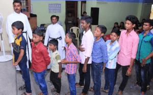 Children in BFM's Sunday School Wait Their Turn To Receive School Supplies