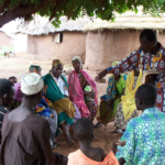 A church planter shares the Gospel in a village.
