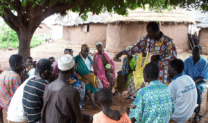A church planter shares the Gospel in a village.