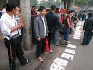 Migrant workers waiting for employers at an open market