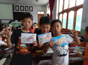 Children paint pictures in the meeting