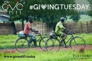 Men on bikes with Giving Tuesday graphic