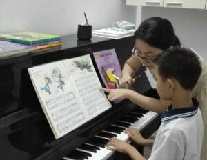 Piano Lessons Help Reach a Community for Christ