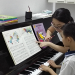 Piano class for migrant workers children