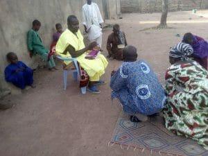 J G kneeling to greet Sheikh Issa as custom demands