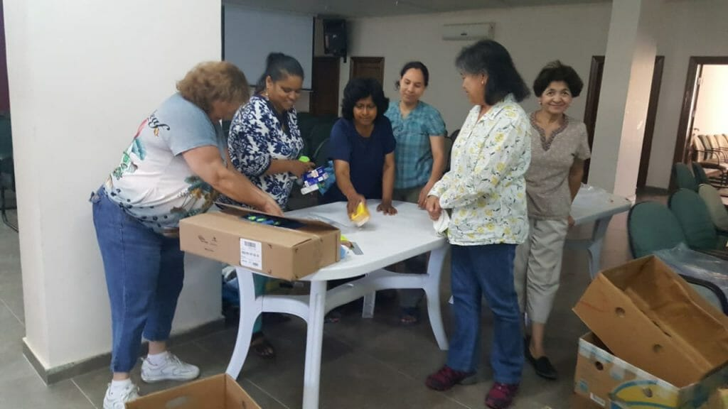 JEPM3 women packaging gifts for inmates