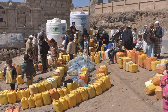 People waiting in lines for water